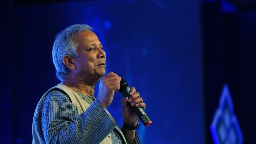 "Nobel laureate Muhammad Yunus speaks during the Social Business Day in Dhaka on June 28, 2013. Bangladesh's cabinet has ordered ""legal action"" against 2006 Nobel Peace Prize winner Muhammad Yunus, accusing him of avoiding taxes on income from awards, book royalties and foreign tours."