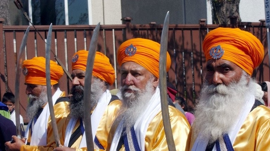 Baptised Sikhs, known as the beloved ones, march in a parade with karpans (swords) April 10, 2004 in Vancouver, Canada.