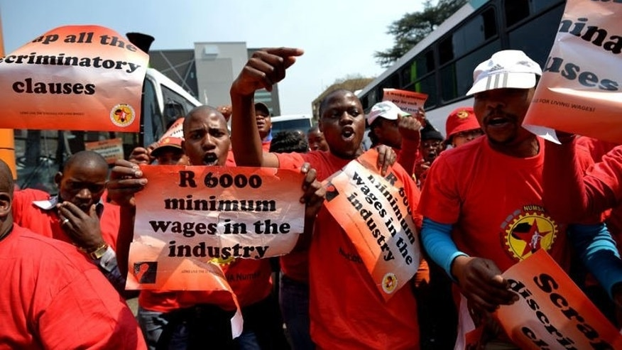 Striking petrol station attendants protest in Johannesburg on September 9, 2013.