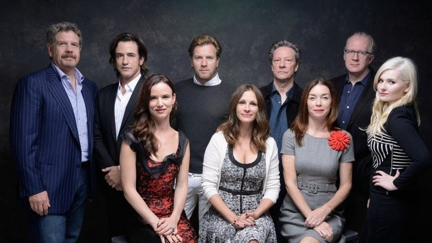 "L-R: Director John Wells, actor Dermot Mulroney, actress Juliette Lewis, actor Ewan McGregor, actress Julia Roberts, actor Chris Cooper, actress Julianne Nicholson, screenwriter Tracy Letts and actress Abigail Breslin of ""August: Osage County"" pose during 2013 Toronto International Film Festival on September 10, 2013 in Toronto, Canada."