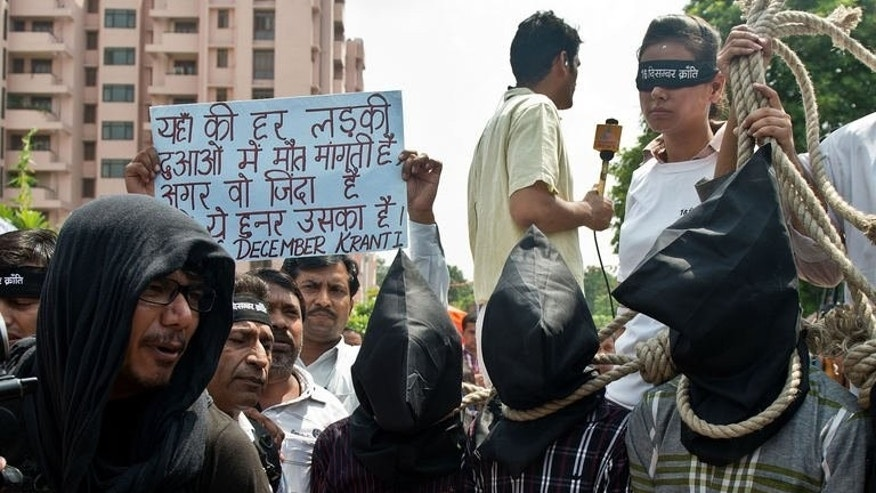 Indian youth protest outside the Saket Court complex in New Delhi on September 10, 2013. The court has convicted four men of the gang rape and murder of a 23-year-old physiotherapy student on board a moving bus last December.