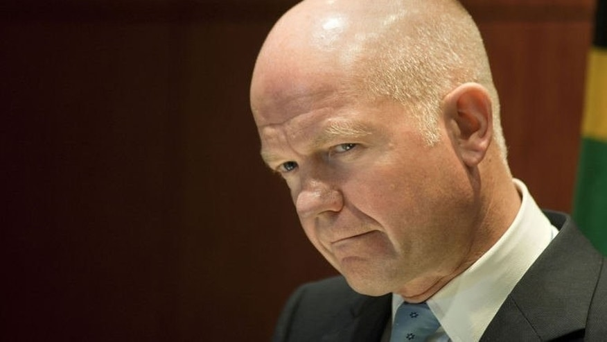 "Foreign Secretary William Hague gives a press conference on September 10, 2013, in Cape Town. Britain would back any ""credible"" UN Security Council resolution on Syria's chemical weapons programme, but it must contain the threat of force, Hague said."