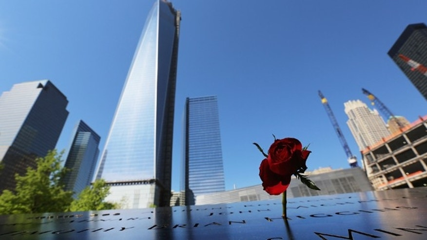 A rose stands at the 9/11 Memorial in front of One World Trade Center. (Photo by Mario Tama/Getty Images)