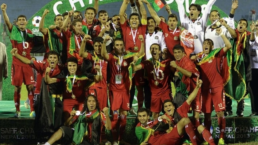 Afghanistan football players celebrate winning the SAFF Championship 2013 trophy after defeating India during the final match in Kathmandu on September 11, 2013. Afghanistan won the match 2-0.
