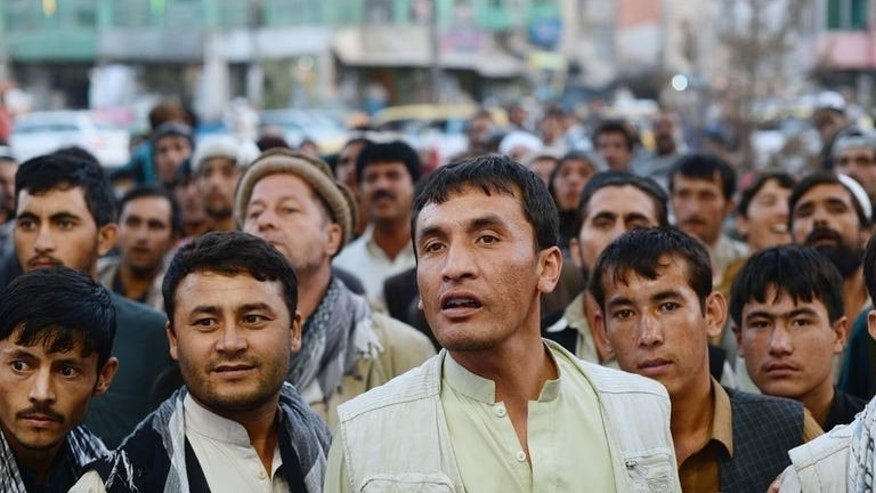 Afghan fans of the football watch a giant TV screen featuring the South Asian Football Federation Championship in Kabul on September 11, 2013.