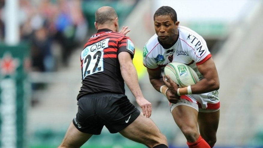 "Toulon's Delon Armitage (right) evades a challenge by Charlie Hodgson of Saracens at Twickenham on April 28. Plans to establish an Anglo-French rival to rugby union's existing European Cup next season were ""inevitable"", the chairman of English Premiership side Saracens said Wednesday."