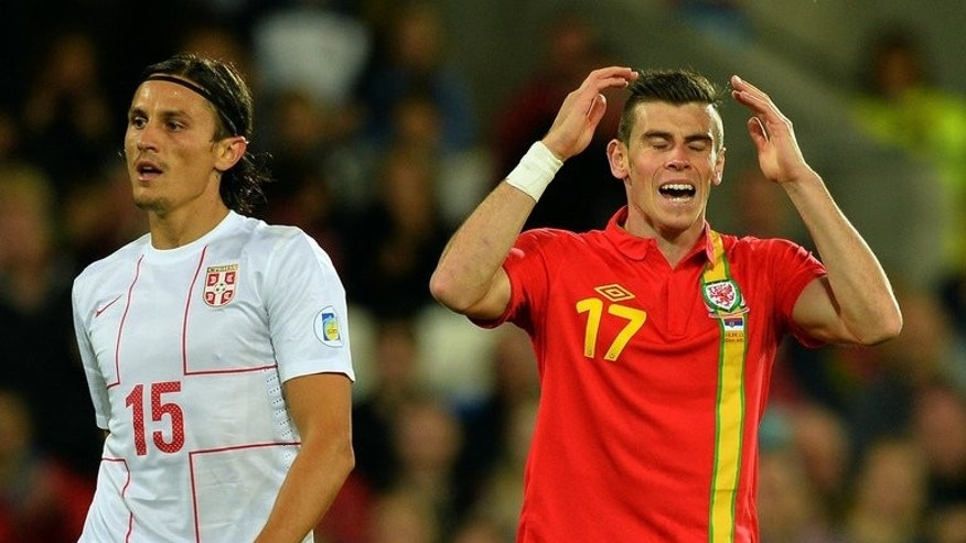 "Gareth Bale (right) with Serbia's Ljubomir Fejsa during the World Cup qualifier in Cardiff on Tuesday. Wales manager Chris Coleman has said it would be ""dangerous"" if Real Madrid attempt to play Bale for the whole of their match against Villarreal on Saturday."