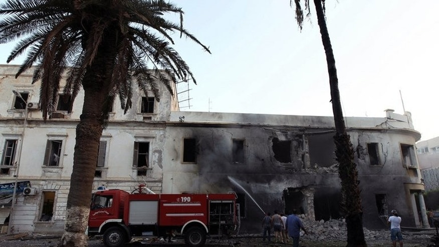 Libyan firefighters battle a fire caused by a powerful blast near a foreign ministry building on September 11, 2013 in the eastern Libyan city of Benghazi.