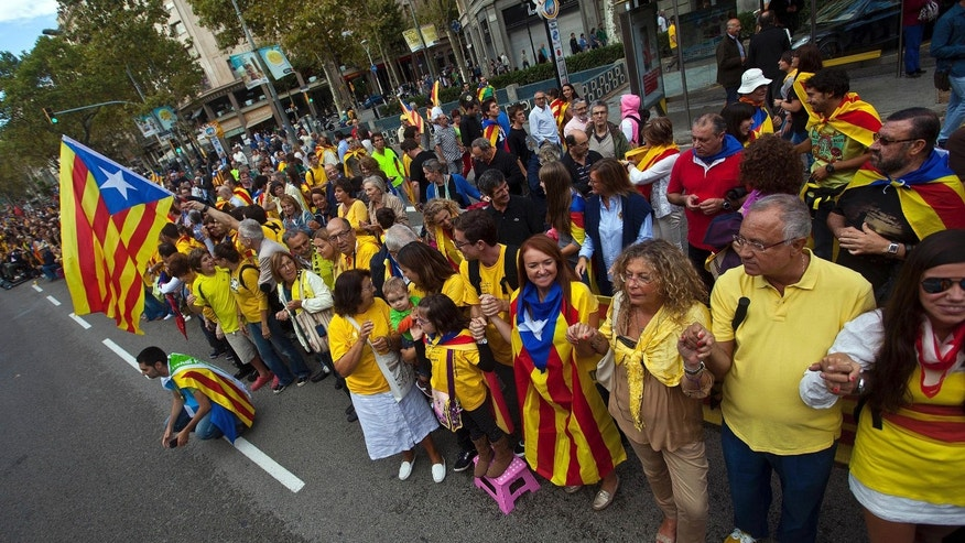 People form a human chain in Barcelona, Spain Wednesday Sept. 11, 2013.