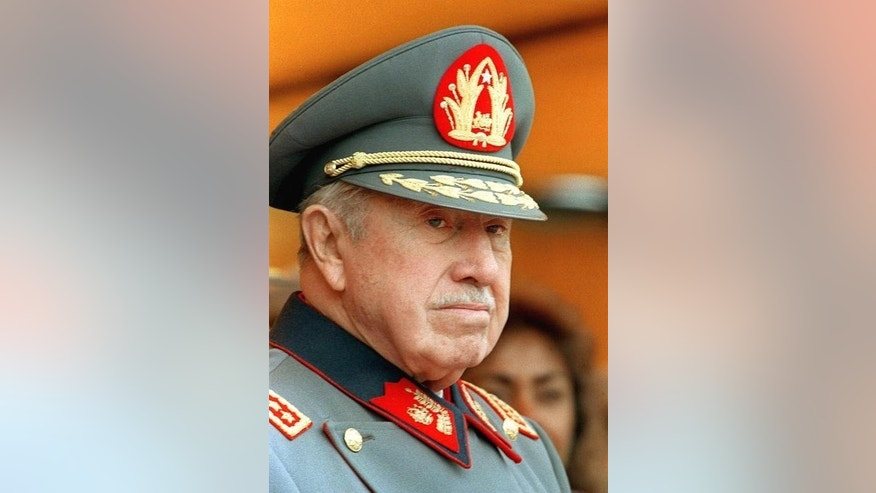 A photo taken on September 7, 1996 shows Chile's former dictator Augusto Pinochet attending a ceremony in Santiago.