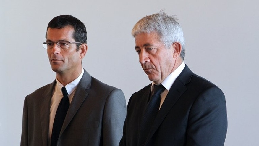 The ex-captain of the British ferry Condor Vitesse, Paul Le Romancer (left) and his first mate Yves Tournon stand in court in Coutances before the start of their trial on June 26, 2013. The captain and first mate of a British ferry that sliced into a fishing boat at high speed, killing its skipper, were convicted of manslaughter by a French court.