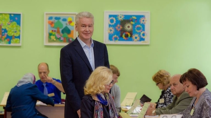 Incumbent Moscow mayor Sergei Sobyanin visits a polling station in Moscow, on September 8, 2013. Russian President Vladimir Putin is to attend the inauguration Thursday of his close ally Sobyanin as Moscow mayor, despite claims of foul play in weekend polls from his anti-Kremlin rival who plans to send a truck-load of complaints to court.