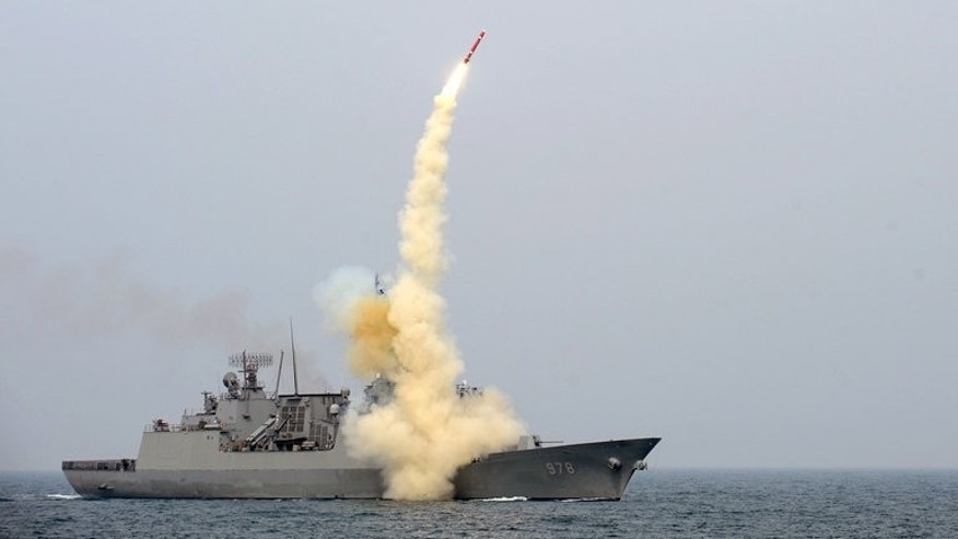 The South test launches a cruise missile in a picture released February 14, 2013. Seoul said Wednesday it would show off a missile capable of striking the North's command headquarters.