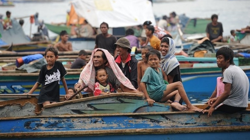 Residents of Zamboanga in boats after evacuating the city's boulevards on September 11, 2013. Thousands have fled the city as Philippine security forces battle Muslim rebels.