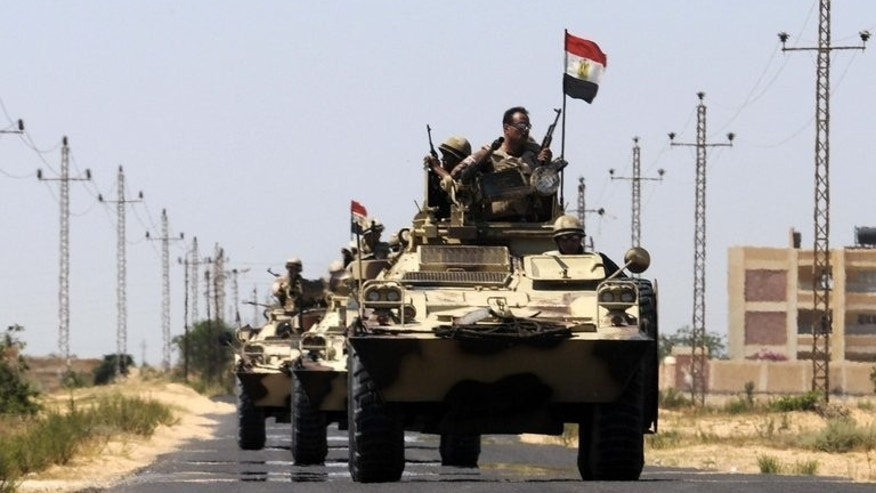 File picture shows Egyptian soldiers deployed in the area of the Rafah border crossing on May 21, 2013. At least three soldiers were killed in a twin attack on the army in Egypt's Sinai peninsula on Wednesday, a security official said.