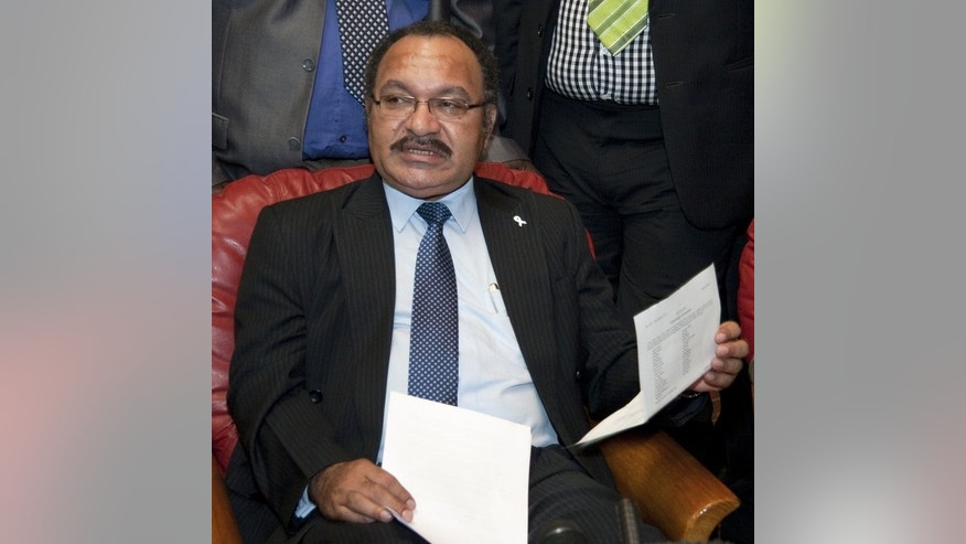 Papua New Guinea Prime Minister Peter O'Neill, pictured on December 15, 2011. He said the tribespeople involved in an attack on a trekking group would face the death penalty if caught and convicted.