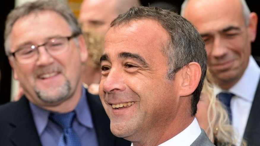Coronation Street actor Michael Le Vell walks free from Manchester Crown Court on September 10, 2013.
