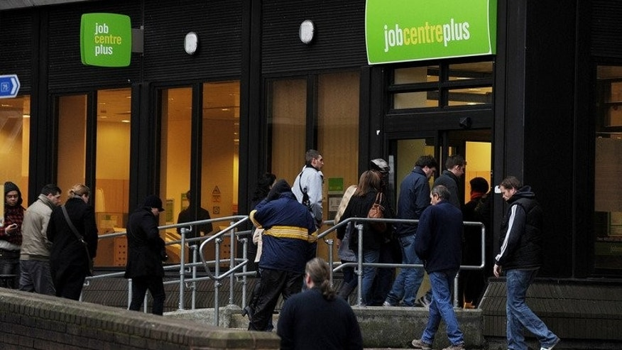 People enter a job centre in Bromley on January 20, 2010. Britain's unemployment rate eased to 7.7 percent in the three months to July, official data showed.