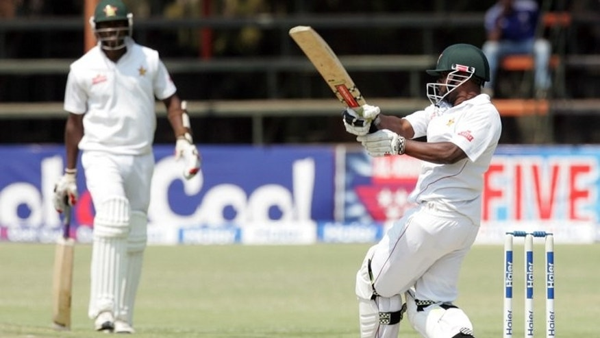 Prosper Utseya strikes the ball against Pakistan at the Harare Sports Club on Wednesday. Pakistan reached 24 for no wicket at lunch in reply to Zimbabwe's first innings total of 294 all out on the second day of the second Test at Harare Sports Club on Tuesday.