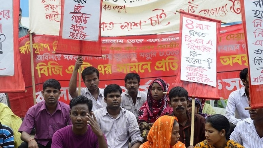 Bangladeshi garment workers, activists and relatives of those who lost their lives in a garment factory disaster, protest in Dhaka on August 24, 2013. The disaster placed the international spotlight on the often appalling conditions and the lack of rights for workers at the country's 4,500 garment factories, and retailers responded with a pledge to improve safety.