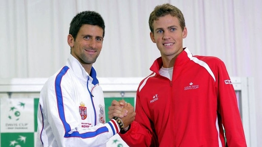 Captains of the Serbian and Canadian Davis Cup teams Novak Djokovic (L) and Vasek Pospisil shake hands during the draw ceremony for the upcoming Davis Cup semi-final tennis match in Belgrade on September 12, 2013.