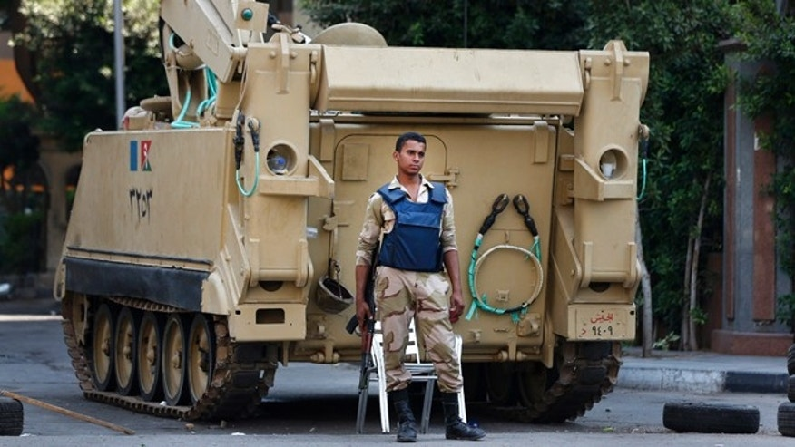 Sept. 10, 2013: An Egyptian soldier stands guard next to an armored personnel carrier in Cairo, Egypt.