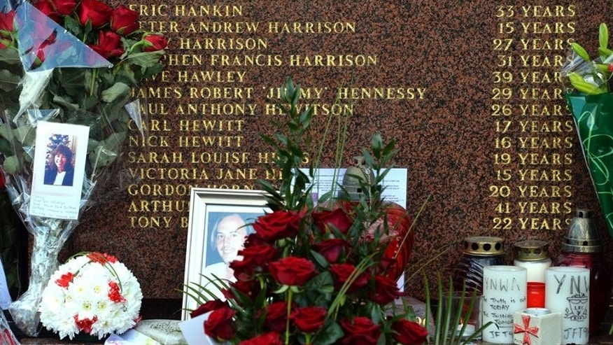 Flowers and pictures are placed at the Hillsborough Memorial at Liverpool FC's Anfield football ground in Liverpool, north-west England, on April 15, 2013. Witness statements from fans present at the Hillsborough disaster may have been altered by police, according to a body investigating allegations of police corruption.