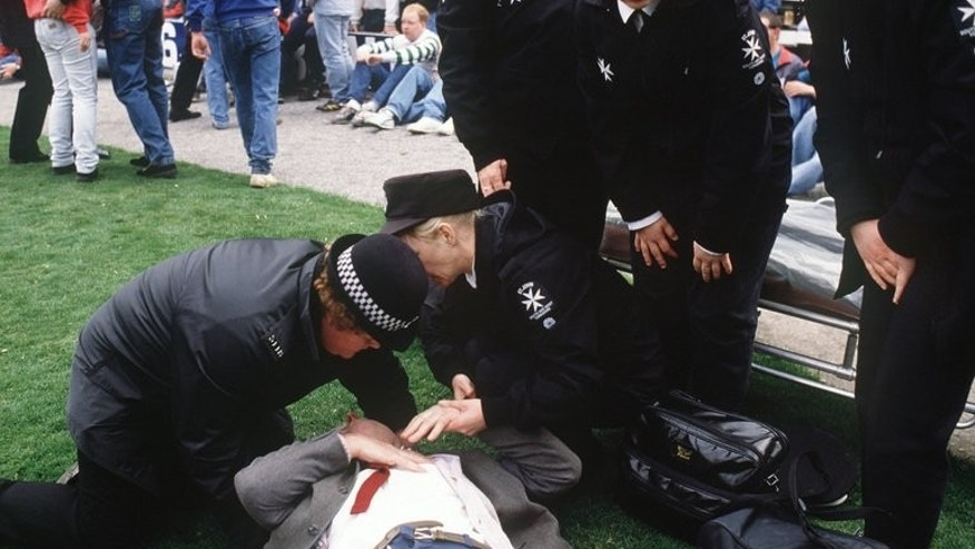Policewomen help fans at Hillsborough stadium in Sheffield on April 15, 1989 when 96 fans were crushed to death and hundreds injured after support railings collapsed during an FA Cup semi-final between Liverpool and Nottingham Forest. Witness statements from fans present at the Hillsborough disaster may have been altered by police, according to a body investigating claims of police corruption.