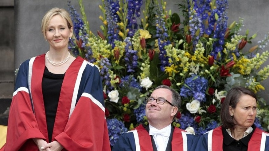 J.K. Rowling (left) at an awards ceremony at the University of Edinburgh, Scotland, in 2011. The Harry Potter author is writing a series of spin-off films set in the magical world of the British boy wizard, she announced on Thursday.