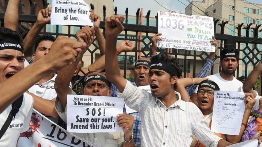 Indian protestors shouts slogans during a demonstration outside the Saket Court complex in New Delhi on September 11, 2013.