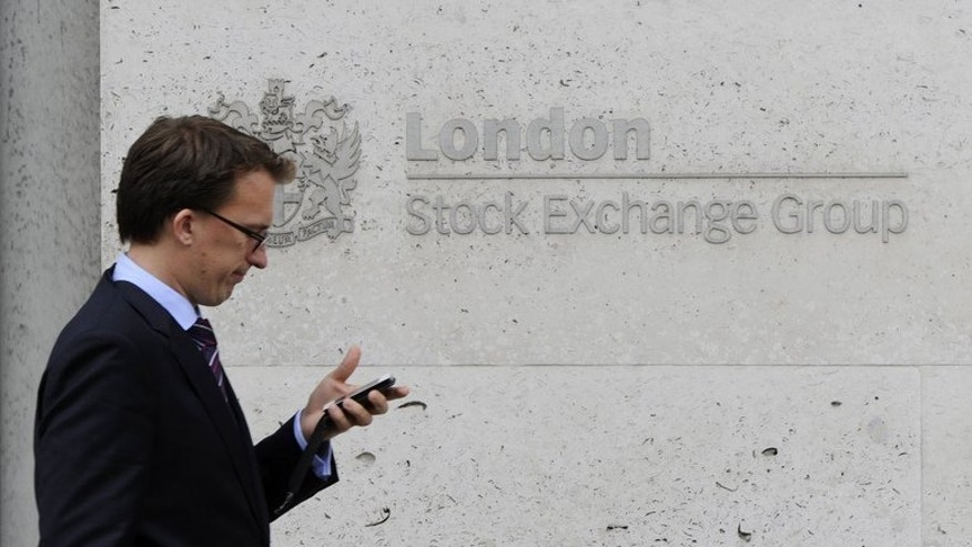 A man walks past the London Stock Exchange, in central London, on September 22, 2011. London shares close flat at the end of trade as traders reacted to a drop in eurozone industrial production and awaited a key meeting on Syria.