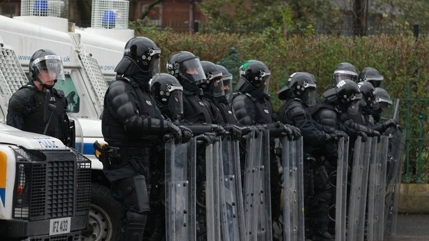 Police in riot gear watch Loyalist protesters in east Belfast in January. Northern Ireland has failed to establish the truth about abuses committed during its civil unrest and as a result will struggle to move forward, Amnesty International warned on Thursday.