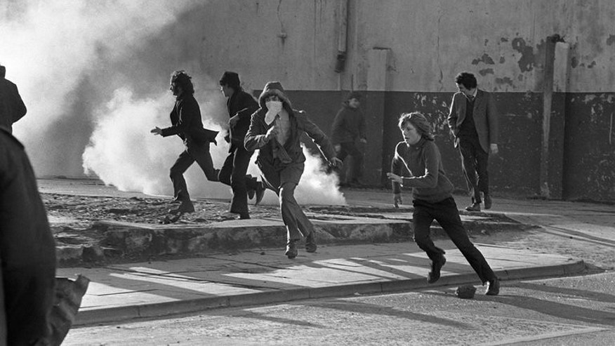 Young Catholic rioters hurl projectiles at British soldiers in Derry in 1972. The conflict, between Catholic republican communities who wanted Northern Ireland to become part of Ireland and Protestants who wanted to stay part of Britain, was largely brought to an end under a 1998 peace deal.