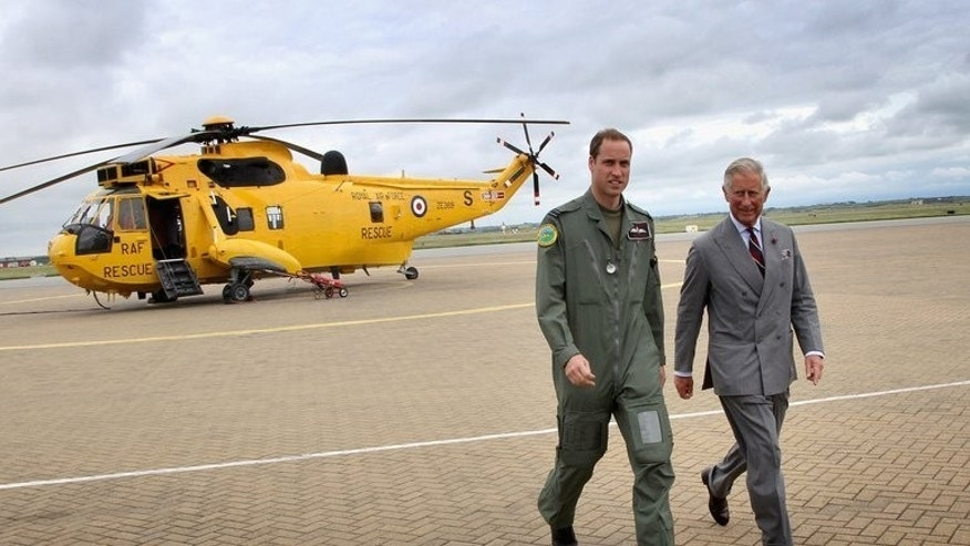 Prince William (left) and father Prince Charles leave a helicopter at RAF Valley, north-west England, in July last year. William has completed his tour as a Royal Air Force search and rescue helicopter pilot and left the armed forces, the royal family said Thursday.