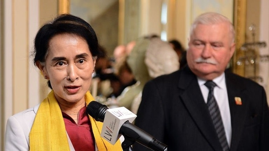 Myanmar's opposition leader Aung San Suu Kyi (L) speaks during a joint press conference with former Polish President Lech Walesa on September 12, 2013 in Warsaw, Poland.
