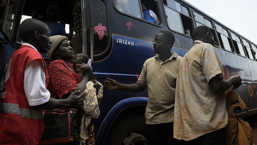 "Burundi refugees arrive at a transit camp in Musenyi, south Burundi last November after returning from Tanzania. At least 25,000 Burundian refugees living in Tanzania have been forcibly repatriated over the past month, a UN official said Thursday, describing a ""dramatic"" humanitarian situation."