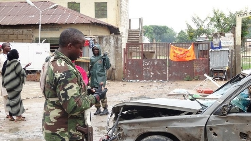 A soldier stands at the scene of an explosion in the downtown Sabon Gari neighbourhood of Kano on July 30, 2013.