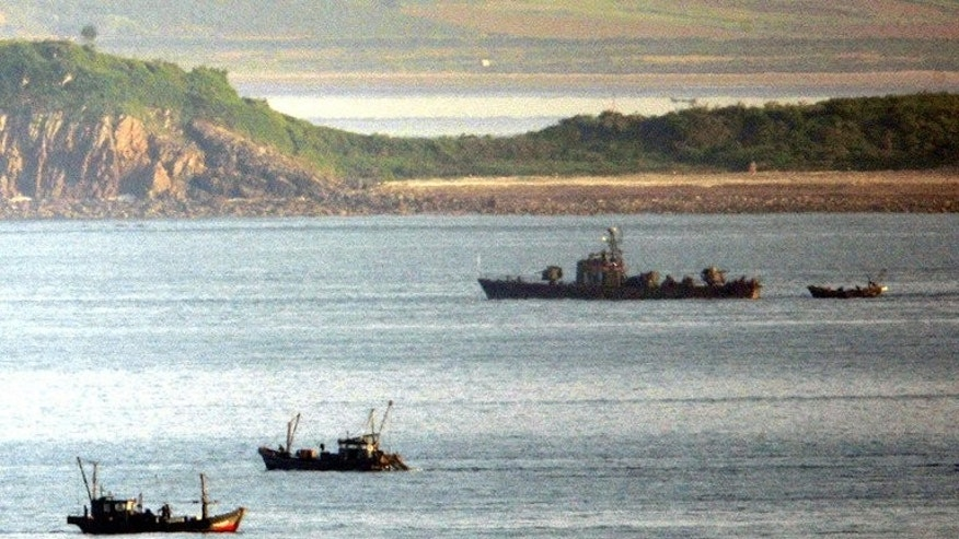 A North Korean navy patrol boat is seen amongst fishing boats close to Yeonpyeong island in disputed waters of the Yellow Sea, on May 31, 2009. A South Korean man has escaped four decades after he was kidnapped by North Korea while fishing near the disputed Yellow Sea border.