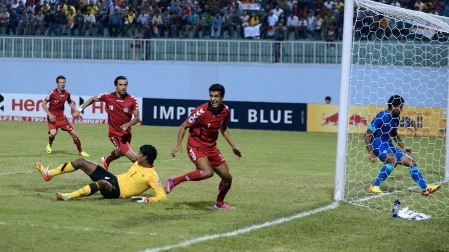Mustafa Azadzoy (centre) scores for Afghanistan against India in Kathmandu on wednesday.