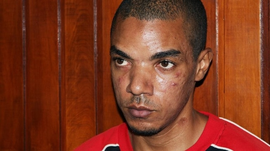 Briton Jermaine Grant sits in court in Kenya's coastal town of Mombasa on May 9, 2012. A court in Kenya on Friday acquitted alleged British Islamist militant Jermaine Grant of robbery charges, but his separate trial for possession of explosives continues, magistrates said.
