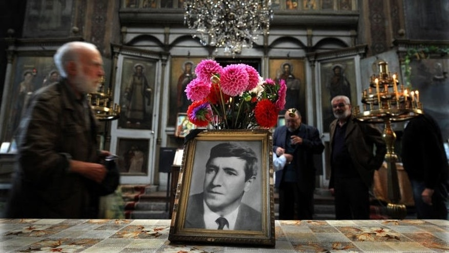 """People attend a service marking 35 years since the death of Georgi Markov, a Bulgarian disident killed in London in 1978, in a church in Sofia on September 11, 2013. Bulgaria is set to close a 35-year probe into the spectacular """"umbrella killing"""" of Markov. Markov's murder has gone down as one of the most daring and extraordinary crimes of the Cold War."""