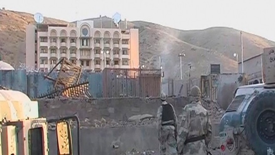 Sept. 13, 2013: Soldiers walk towards the U.S. Consulate after an attack by insurgents in the western Afghanistan city of Herat, in this video still image.