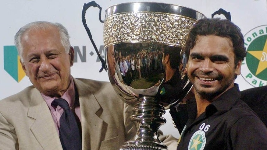 Faisalabad Wolves skipper Naveed Latif (right) receives the ABN Amro Twenty20 Cup in Lahore in 2005
