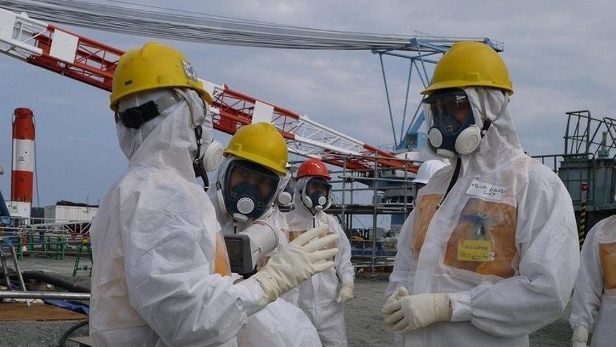 "Nuclear safety experts inspect TEPCO's Fukushima Dai-ichi nuclear power plant in Okuma, on September 12, 2013. The Japanese government and TEPCO are scrambling to reassure people that they have a lid on Fukushima after a senior utility executive said the nuclear plant was ""not under control""."
