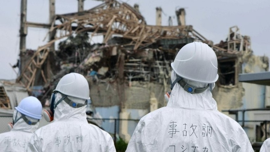 "Japanese officials inspect TEPCO's Fukushima Dai-ichi nuclear power plant in Okuma, on June 18, 2011. The Japanese government and TEPCO are scrambling to reassure people that they have a lid on Fukushima after a senior utility executive said the nuclear plant was ""not under control""."