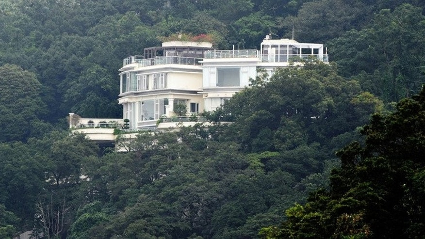 A luxury house stands among green hills on the Peak of Hong Kong on October 25, 2009. A government minister's suggestion this week that developing the city's green spaces should no longer be off limits drew scorn from environmentalists, adding to concerns that Hong Kong's natural habitats are slowly being eroded by developers.