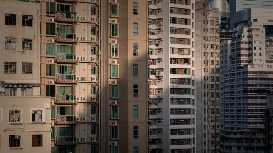High-rise buildings in Hong Kong on September 10, 2013. As one of the world's most densely populated cities, Hong Kong is searching for more space to house thousands priced out of its sky-high property market -- raising fears for its cherished nature reserves
