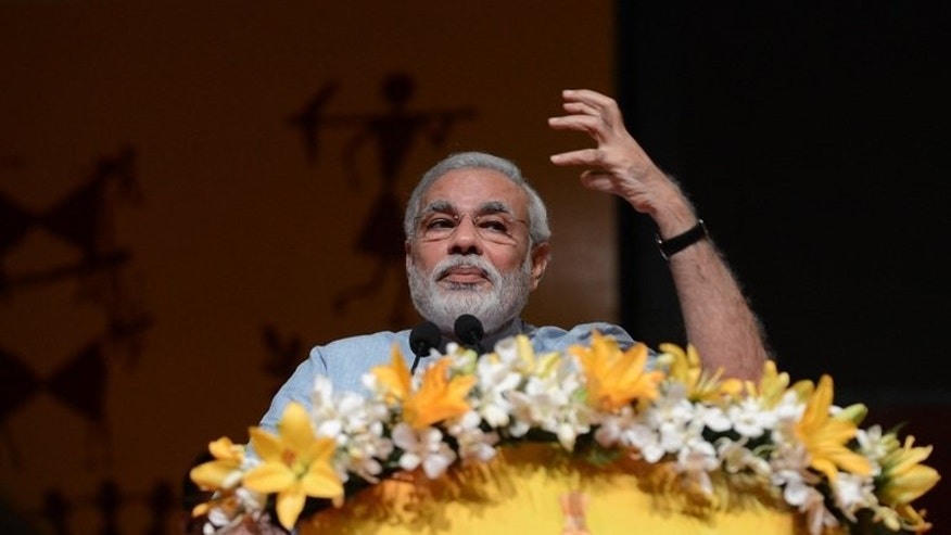 Gujarat state Chief Minister Narendra Modi gives a speech in Gandhinagar, on September 9, 2013. India's main opposition party is expected Friday to announce the hardline Hindu nationalist as its prime ministerial candidate for elections next year, overriding concerns about his polarising character.