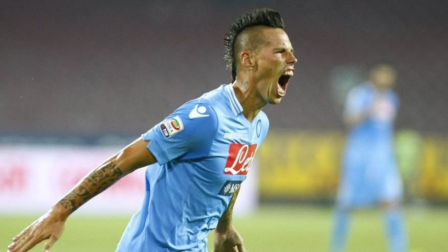 Napoli's Marek Hamsik celebrates after scoring during the Italian Serie A match against Bologna at San Paolo Stadium in Naples on August 25, 2012.