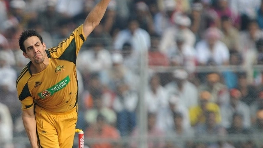 Australian bowler Mitchell Johnson delivers a ball during the sixth one-day international match between India and Australia at the Nehru Stadium in Guwahati on November 8, 2009.